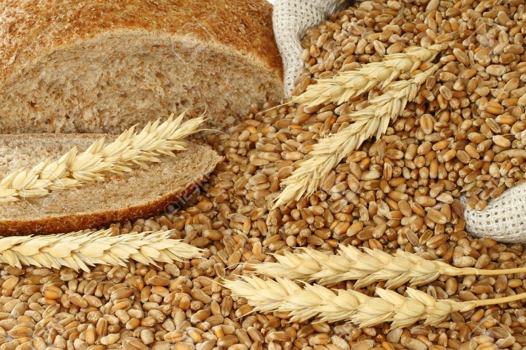 14967366-Bread-a-bag-with-wheat-and-ears-close-up-Stock-Photo